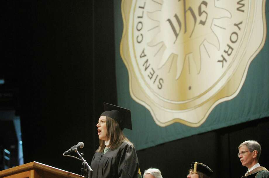 Graduate Catherine Santino sings the National Anthem during the college commencement ceremony for Siena College at the Times Union Center on Sunday, May 19, 2013 in Albany, NY.  (Paul Buckowski / Times Union) Photo: Paul Buckowski