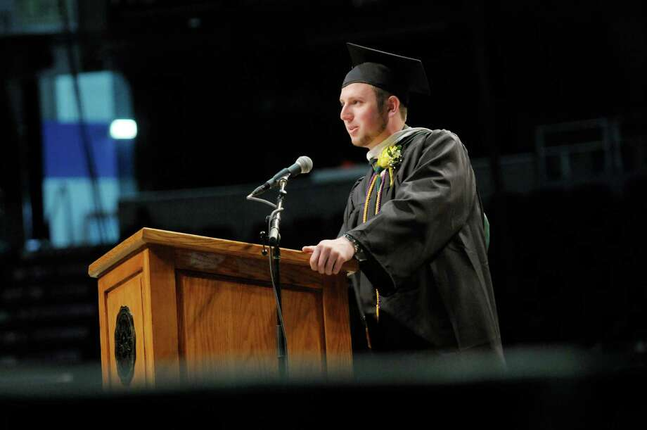Graduate and class president, Joseph Stinton, addresses those gathered during the college commencement ceremony for Siena College at the Times Union Center on Sunday, May 19, 2013 in Albany, NY.  (Paul Buckowski / Times Union) Photo: Paul Buckowski