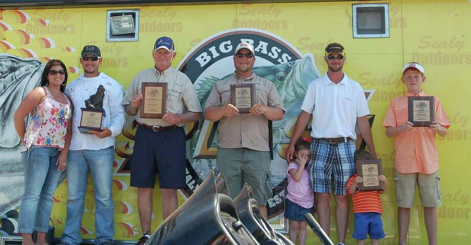 Wesley Thomas won the 27th annual Big Bass Splash on Toledo Bend with his 9.62-pound day-one catch. From left: Wesley's wife stands by him as he is crowned champion, followed by Bill Ligon (9.48 pounds), second place; third-place Derek Mong (9.36 pounds), third place; fourth place Nick Simon (9.23 pounds), fourth place; and 5th place Cole Moore (8.36 pounds), fifth place.
