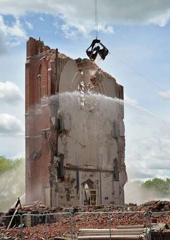 St. Patrick's bell tower is slowly picked apart as demolition of the former church continues in Watervliet, NY Friday May 17, 2013.  (John Carl D'Annibale / Times Union) Photo: John Carl D'Annibale / 00022425A