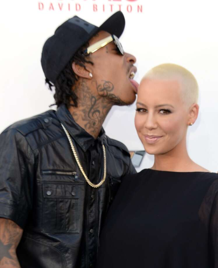 LAS VEGAS, NV - MAY 19:  Wiz Khalifa (L) and Amber Rose arrive at the 2013 Billboard Music Awards at the MGM Grand Garden Arena on May 19, 2013 in Las Vegas, Nevada.  (Photo by Jason Merritt/Getty Images)