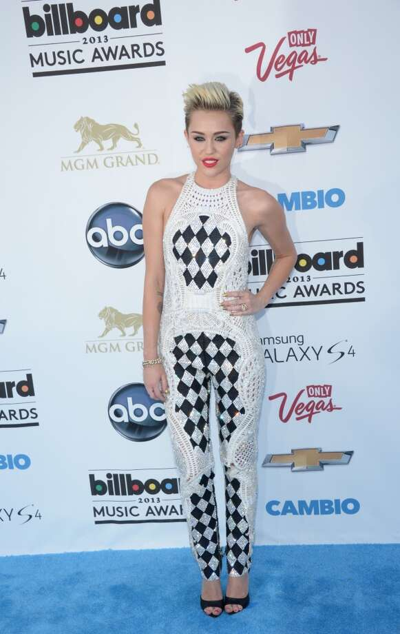 Singer and actress Miley Cyrus arrives on the red carpet at the 2013 Billboard Music Awards at the MGM Grand in Las Vegas, Nevada, May 19, 2013.   AFP PHOTO / ROBYN BECKROBYN BECK/AFP/Getty Images