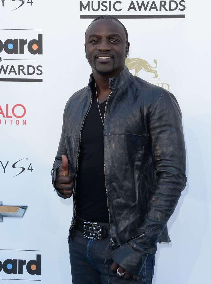 LAS VEGAS, NV - MAY 19:  Recording artist Akon arrives at the 2013 Billboard Music Awards at the MGM Grand Garden Arena on May 19, 2013 in Las Vegas, Nevada.  (Photo by Jason Merritt/Getty Images)
