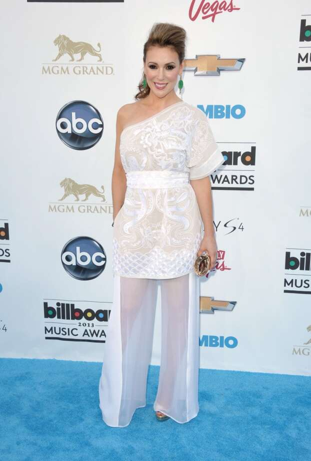 Alyssa Milano arrives at the Billboard Music Awards at the MGM Grand Garden Arena on Sunday, May 19, 2013 in Las Vegas. (Photo by John Shearer/Invision/AP)