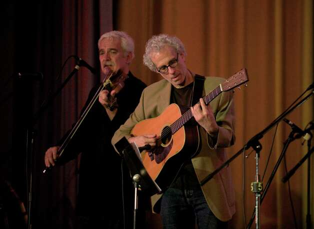 Dick Neil, on guitar, and Howie Bujese , on violin, perform during The Flagpole Radio Cafe, a locally produced musical variety and comedy show at Edmond Town Hall in Newtown, Conn. on Saturday, May 18, 2013. Photo: H John Voorhees III
