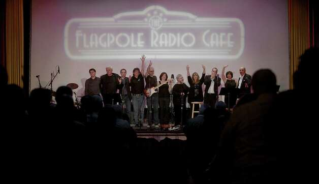 The cast of The Flagpole Radio Cafe, a locally produced musical variety and comedy show, in Newtown Conn. wave goodbye at the end of the show on Saturday, May 18, 2013. Photo: H John Voorhees III