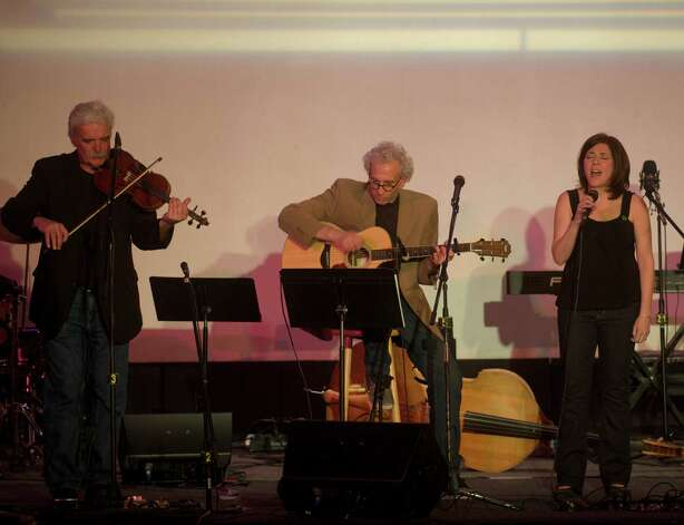 Howie Bujese, on violin, Dick Neil, on guitar and Francine Wheeler singing during The Flagpole Radio Cafe at Edmond Town Hall in Newtown, Conn. on Saturday, May 18, 2013. Photo: H John Voorhees III