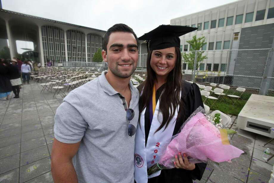 Zach Siegman, left, and Marisa Zucker, right, at the graduation commencement ceremonies at the University of Albany on Sunday, May 19, 2013. (Erin Pihlaja / Special to the Times Union)