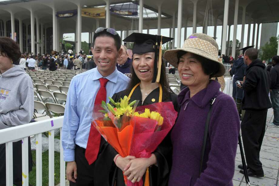 Alvin Chen, left, Kaori Chen, center, and Mei Chen, right, at the graduation commencement ceremonies at the University of Albany on Sunday, May 19, 2013. (Erin Pihlaja / Special to the Times Union)