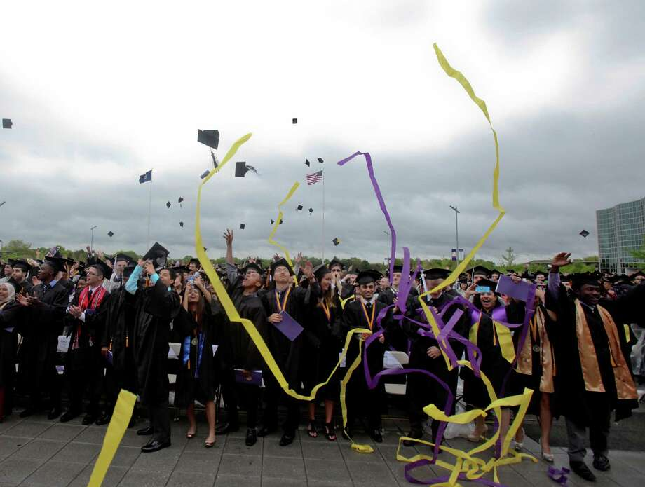 Students celebrate at the graduation commencement ceremonies at the University of Albany on Sunday, May 19, 2013. (Erin Pihlaja / Special to the Times Union)