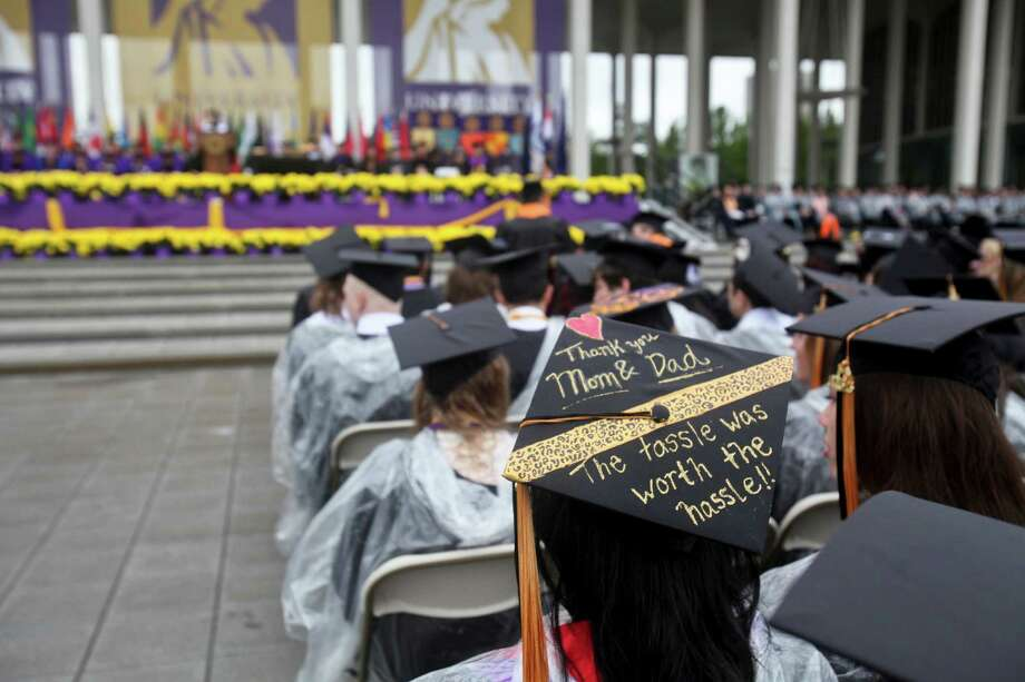 Some students at the graduation commencement ceremonies at the University of Albany on Sunday, May 19, 2013, used the space on their hats to convey special messages. (Erin Pihlaja / Special to the Times Union)