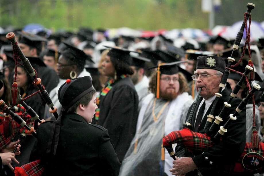 The sound of the Adirondack Pipes and Drums band kicked off the graduation commencement ceremonies at the University of Albany on Sunday, May 19, 2013. (Erin Pihlaja / Special to the Times Union)