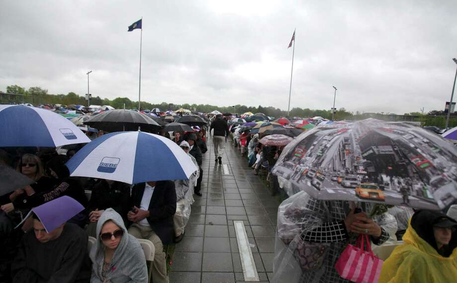 Rain did not deter friends and family at the graduation commencement ceremonies at the University of Albany on Sunday, May 19, 2013. (Erin Pihlaja / Special to the Times Union)