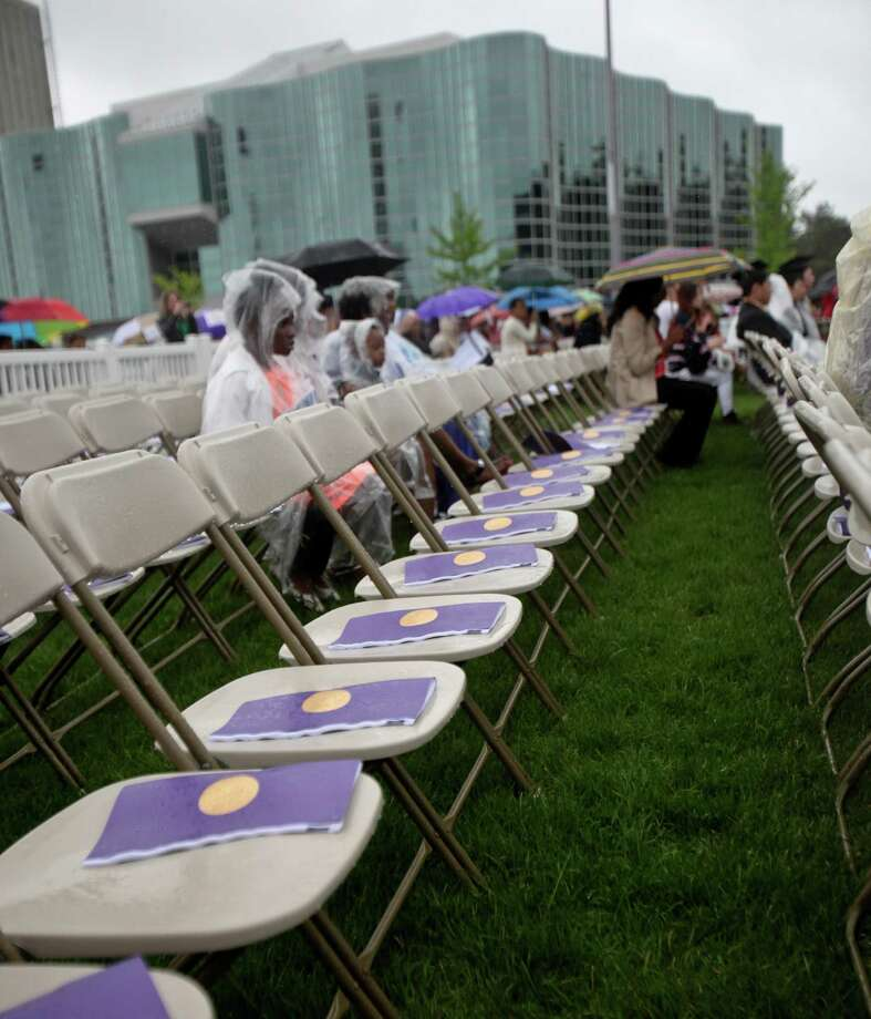 Although it was a soggy scene, rain did not completely dampen the graduation commencement ceremonies at the University of Albany on Sunday, May 19, 2013. (Erin Pihlaja / Special to the Times Union)