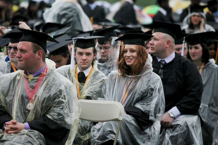 Benjamin Bagenski, center left, and Sara Ventura, center right, wait for graduation commencement ceremonies to begin at UAlbany on Sunday, May 19, 2013. (Erin Pihlaja / Special to the Times Union.