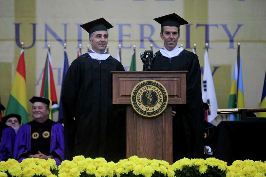 Brothers and alumni Avery Lipman, left, and Monte Lipman, right, at the graduation commencement ceremonies at the University of Albany on Sunday, May 19, 2013. The Lipmans own Republic Records. (Erin Pihlaja / Special to the Times Union)