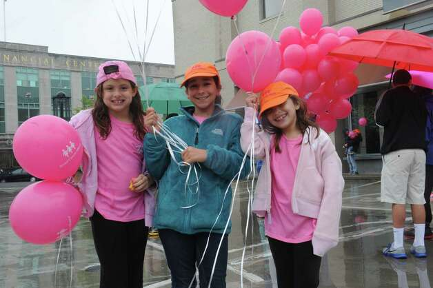 "Francesca Buno, 10, Julianna Darcy, 7, C.C.Buono, 7, gives balloons to people at the Breast Cancer Alliance's ""Walk for Hope,"" at Richard's on Greenwich Avenue, in Greenwich, Sunday, May 19, 2013. The Alliance funds breast cancer research. Photo: Helen Neafsey / Greenwich Time"