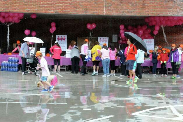 "In spite of the rain,  Breast Cancer Alliance's ""Walk for Hope,"" brought many people came to the walk, at Greenwich Avenue, in Greenwich, Sunday, May 19, 2013. The Alliance funds breast cancer research. Photo: Helen Neafsey / Greenwich Time"