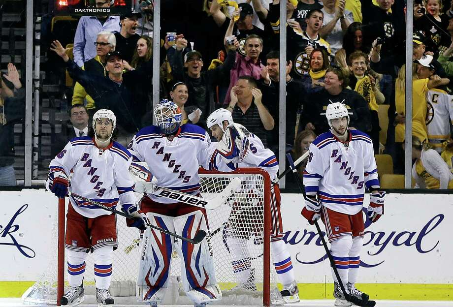 New York Rangers goalie Henrik Lundqvist, second from left, and teammates right wing Mats Zuccarello (36), defenseman Dan Girardi (5) and center Derick Brassard (16) react after the Boston Bruins scored their fifth goal during the third period in Game 2 of the NHL Eastern Conference semifinal hockey playoff series in Boston, Sunday, May 19, 2013. The Bruins won 5-2. (AP Photo/Elise Amendola) Photo: Elise Amendola