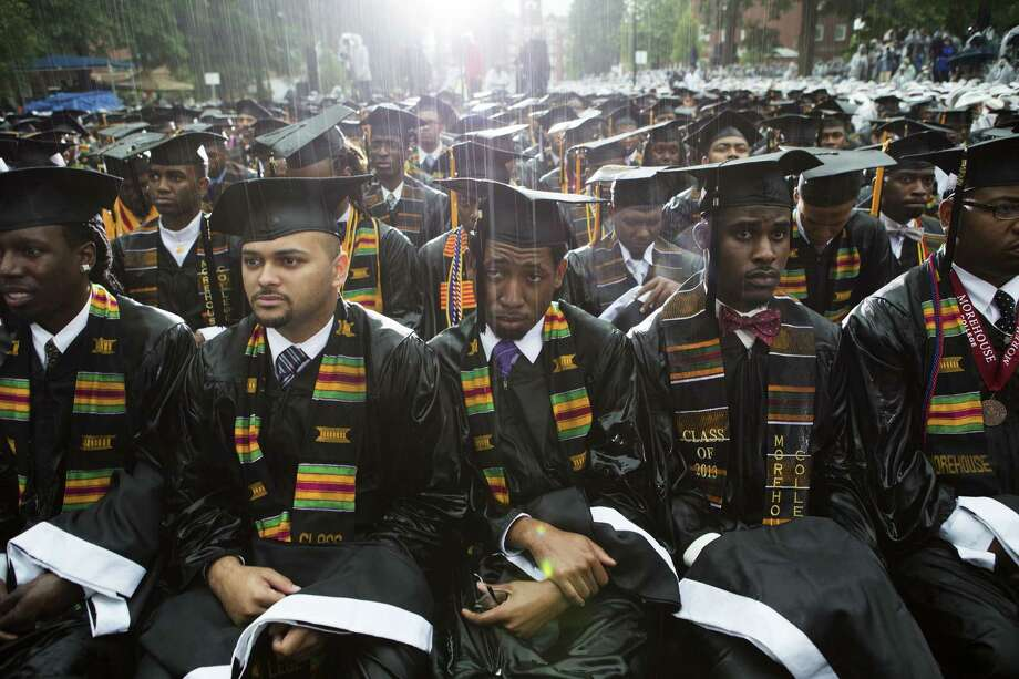Morehouse College graduates sit through a rainstorm as they listen as President Barack Obama talks of his own struggles as a young man and urges them to help other black men succeed. Photo: Doug Mills / New York Times