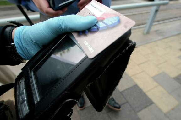 Metro Police Field Training officer Ida Schoener, checks to see how much money is on a rider's Metro rail card at the Metro rail station downtown.