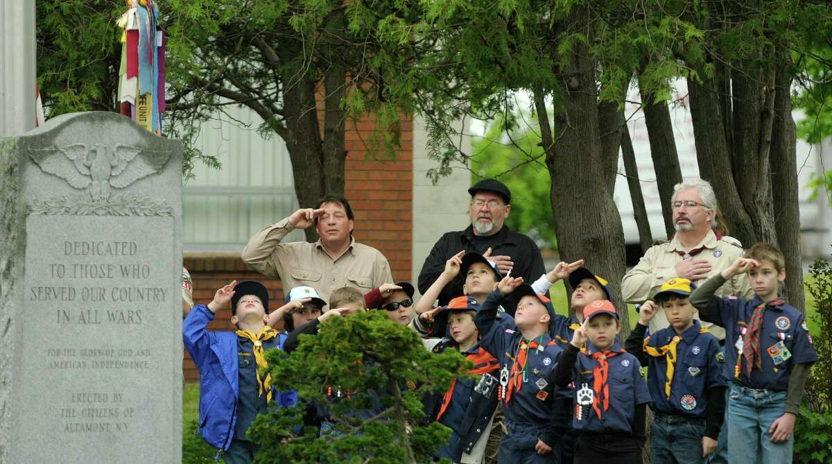 Members of the Cub Scouts Pack 51 and Boy Scouts Troop 264, salute during the Pledge of Allegiance at a ceremony following the Altamont Memorial Day parade on Sunday, May 19, 2013 in Altamont, NY. (Paul Buckowski / Times Union)