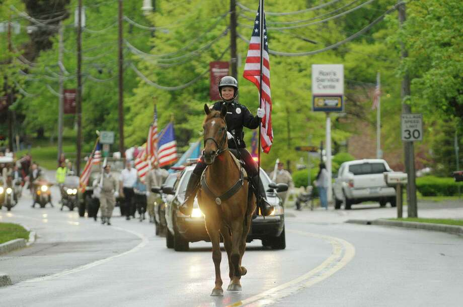 Altamont Police officer Melanie Parkes aboard Humphrey, leads the parade during the Altamont Memorial Day parade on Sunday, May 19, 2013 in Altamont, NY.  (Paul Buckowski / Times Union) Photo: Paul Buckowski