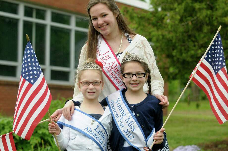 Abbie Leszczynski, left, 7, the Altamont Fair 2012 Little Miss,  Julia Jaster, center, 15, the Altamont Fair 2012 Junior Miss runner-up, and Emma Donvito, 9, the Altamont Fair 2012 Young Miss, pose for a photograph after marching in the Altamont Memorial Day parade on Sunday, May 19, 2013 in Altamont, NY.  (Paul Buckowski / Times Union) Photo: Paul Buckowski