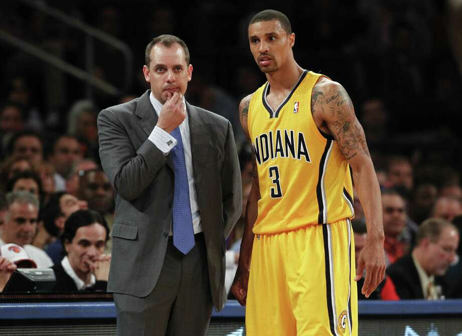 Pacers coach Frank Vogel and guard George Hill are bracing for another physical series against LeBron James and the defending NBA champion Heat. Photo: Jeff Zelevansky / Getty Images
