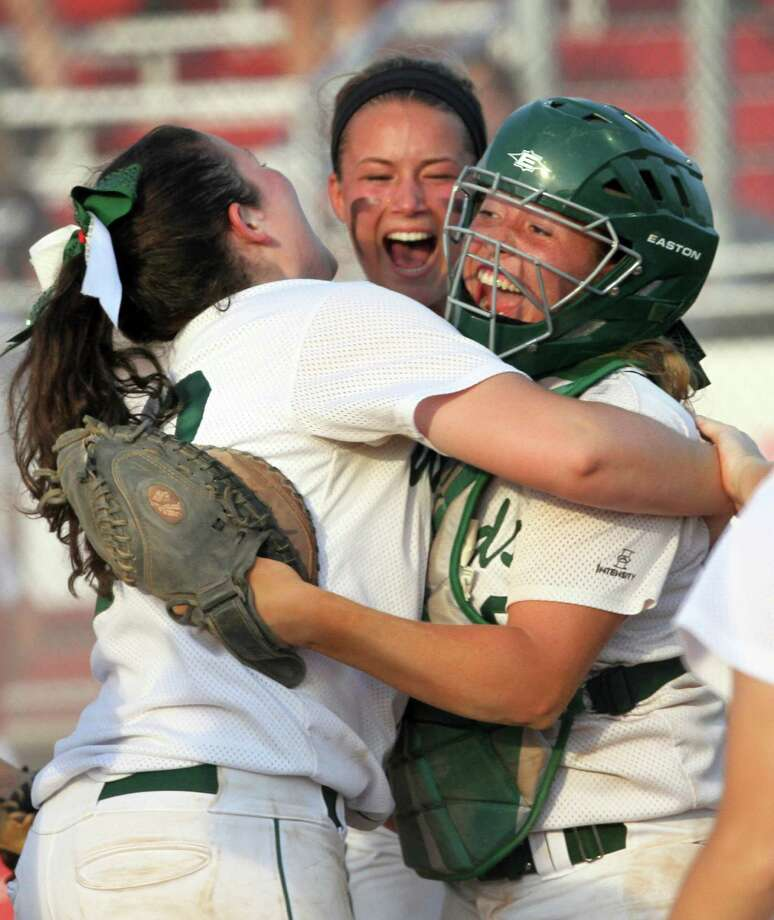 The Woodlands pitcher Caitlin Bartsch celebrates with catcher Brittany Kellett as Abby Langkamp looks on after tagging out McKinney Boyd runner Jill Nicklan to complete a double play in the sixth inning of a Region II-5A semifinal high school softball playoff game on Friday. Photo: Jason Fochtman, MBR / Conroe Courier