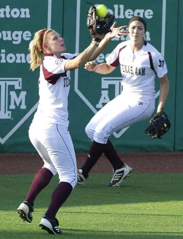A&M's Cali Lanphear makes a catch in the fifth inning just before ending the game with a homer in the bottom half. Photo: Stuart Villanueva / Associated Press