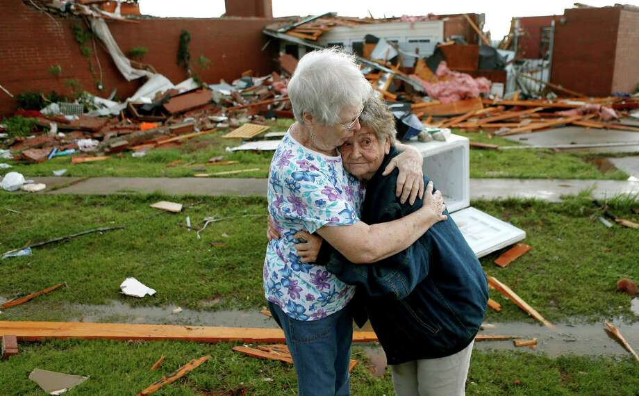 Jerry Dirks, at right, hugs her friend Earlene Langley after a tornado hit Driks' home just south of Carney Okla., on Sunday, May 19, 2013. Dirks was in her cellar at the time the tornado hit. (AP Photo/The Oklahoman, Bryan Terry) Photo: Bryan Terry, Associated Press / The Oklahoman