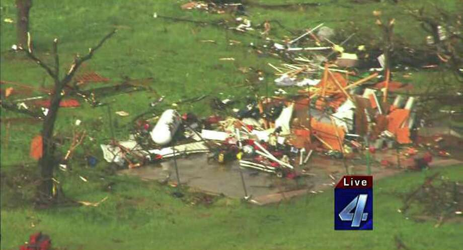 "Damaged structures are seen May 19, 2013 after a tornado ripped through Wellston, Oklahoma. Tornadoes damaged many areas across the state May 19, 2013 and are still forming.  Homes have been destroyed, with the worst damage so far just outside of Wellston.   AFP PHOTO / KFOR-TV     == RESTRICTED TO EDITORIAL  USE / MANDATORY CREDIT:  ""AFP PHOTO / KFOR-TV ""/  NO SALES / NO MARKETING / NO ADVERTISING CAMPAIGNS / DISTRIBUTED AS A SERVICE TO CLIENTS ==