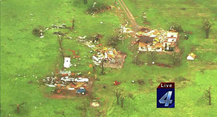 "This imaged obtained courtesy of KFOR-TV shows damaged structures on May 19, 2013 after a tornado ripped through Wellston, Oklahoma. Tornadoes damaged many areas across the state May 19, 2013 and are still forming.  Homes have been destroyed, with the worst damage so far just outside of Wellston.   AFP PHOTO / KFOR-TV     == RESTRICTED TO EDITORIAL  USE / MANDATORY CREDIT:  ""AFP PHOTO / KFOR-TV ""/  NO SALES / NO MARKETING / NO ADVERTISING CAMPAIGNS / DISTRIBUTED AS A SERVICE TO CLIENTS ==-/AFP/Getty Images Photo: -, AFP/Getty Images / AFP"