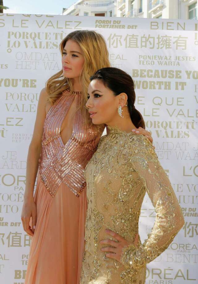 Doutzen Kroes and Eva Longoria attend the cocktail reception for L'Oreal during The 66th Annual Cannes Film Festival on May 17, 2013 in Cannes, France. Photo: Traverso/L'Oreal, Getty Images / 2013 Getty Images