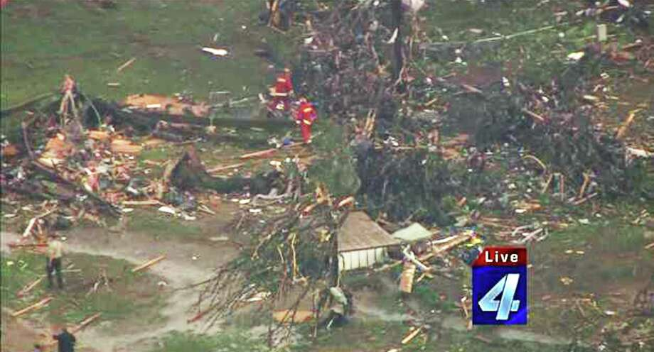 "This photograph obtained courtesy of KFOR-TV in Oklahoma City, Oklahoma shows emergency crews searching amid destruction May 19, 2013 after a tornado ripped through Twin Lakes, Oklahoma. Tornadoes damaged many areas across the  West South Central US state of Oklahoma.     AFP PHOTO / KFOR-TV     == RESTRICTED TO EDITORIAL  USE / MANDATORY CREDIT:  ""AFP PHOTO / KFOR-TV ""/  NO SALES / NO MARKETING / NO ADVERTISING CAMPAIGNS / DISTRIBUTED AS A SERVICE TO CLIENTS ==-/AFP/Getty Images Photo: -, AFP/Getty Images / AFP"