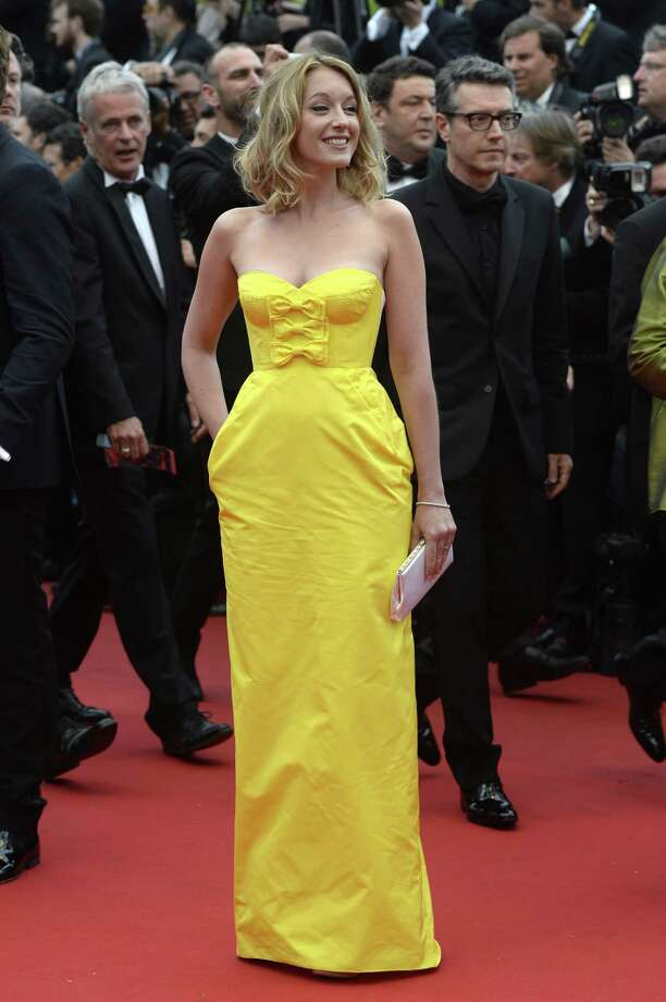 """French actress and member of the Un Certain Regard Jury Ludivine Sagnier smiles on May 16, 2013 as she arrives for the screening of the film """"Young and Beautiful"""" presented in Competition at the 66th edition of the Cannes Film Festival in Cannes. Cannes, one of the world's top film festivals, opened on May 15 and will climax on May 26 with awards selected by a jury headed this year by Hollywood legend Steven Spielberg. Photo: ANNE-CHRISTINE POUJOULAT, Getty Images / 2013 AFP"""