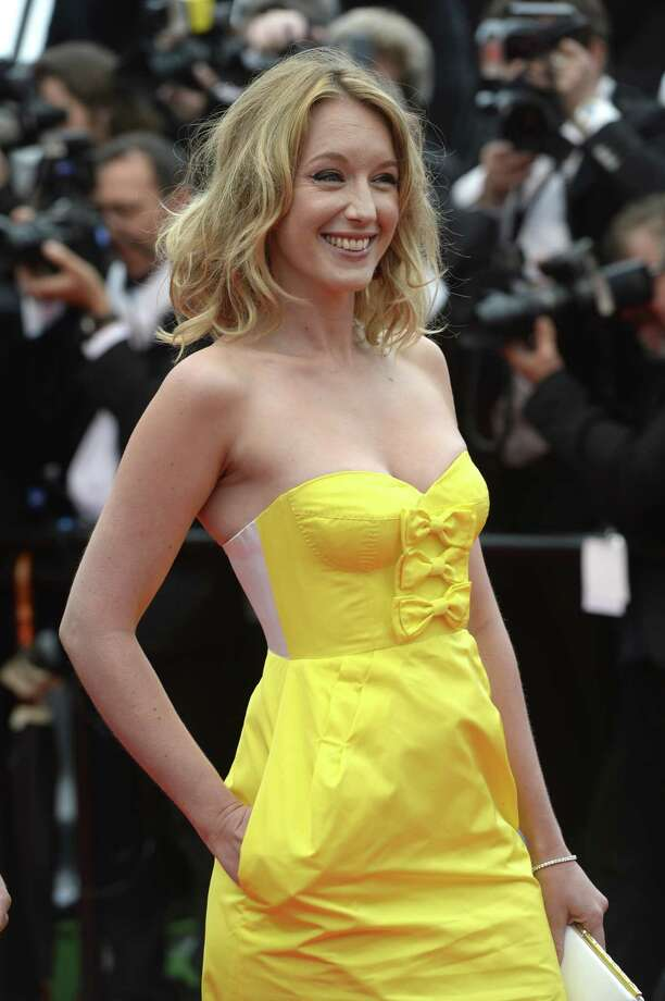 "French actress and member of the Un Certain Regard Jury Ludivine Sagnier smiles on May 16, 2013 as she arrives for the screening of the film ""Young and Beautiful"" presented in Competition at the 66th edition of the Cannes Film Festival in Cannes. Cannes, one of the world's top film festivals, opened on May 15 and will climax on May 26 with awards selected by a jury headed this year by Hollywood legend Steven Spielberg.   AFP PHOTO / ANNE-CHRISTINE POUJOULAT Photo: ANNE-CHRISTINE POUJOULAT, Getty Images / 2013 AFP"
