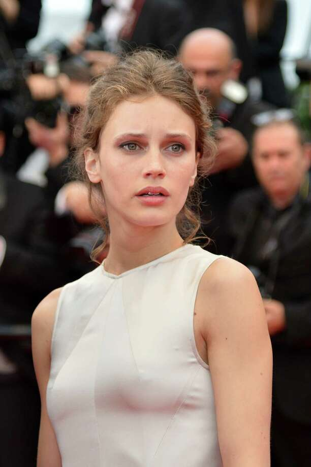 "French actors Marine Vacth arrives on May 16, 2013 for the screening of the film ""Young and Beautiful"" presented in Competition at the 66th edition of the Cannes Film Festival in Cannes. Cannes, one of the world's top film festivals, opened on May 15 and will climax on May 26 with awards selected by a jury headed this year by Hollywood legend Steven Spielberg.      AFP PHOTO / ALBERTO PIZZOLI Photo: ALBERTO PIZZOLI, Getty Images / 2013 AFP"