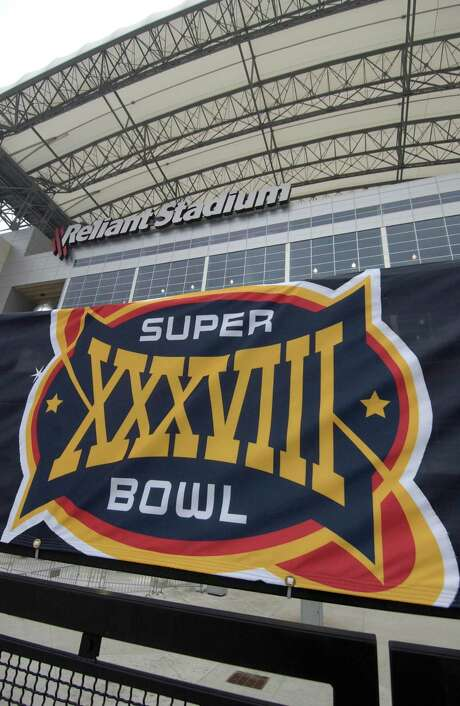 Reliant Stadium at Reliant Park shows off its final decor that will greet football fans on Sunday as they arrive to watch Superbowl XXXVIII between the Carolina Panthers and the New England Patriots. Photo: Karl Stolleis, Staff / Houston Chronicle