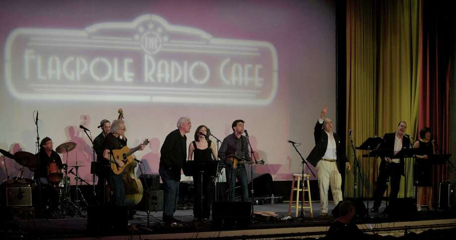 Performing in The Flagpole Radio Cafe, from left to right, Rob Bonacorso, Rick Brodsky, Dick Neil, Howie Bujese, Francine Wheeler, Jim Allyn, Martin Blanco, David Wheeler and Kate Katcher at Edmond Town Hall in Newtown, Conn. on Saturday, May 18, 2013. Photo: H John Voorhees III