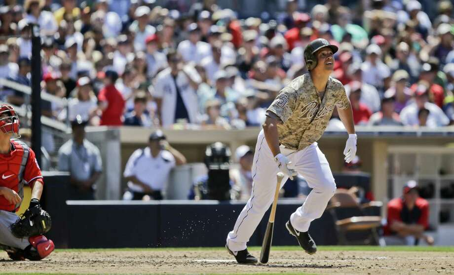 The Padres' Will Venable watches his home run during San Diego's 13-4 win over Washington. Photo: Lenny Ignelzi / Associated Press