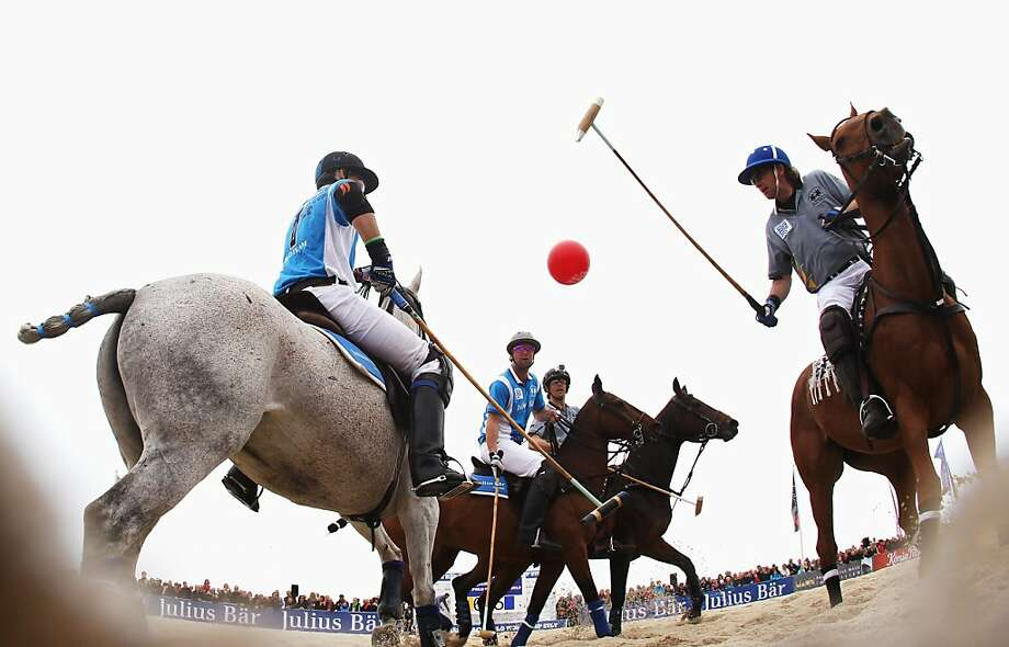 HOERNUM, GERMANY - MAY 19:  Team Maus Immobilien and team Lanson compete for the ball during the Julius Baer Beach Polo World Cup Sylt at Hoernum beach on May 19, 2013 in Hoernum, Germany  (Photo by Joern Pollex/Bongarts/Getty Images) *** BESTPIX *** Photo: Joern Pollex, Bongarts/Getty Images