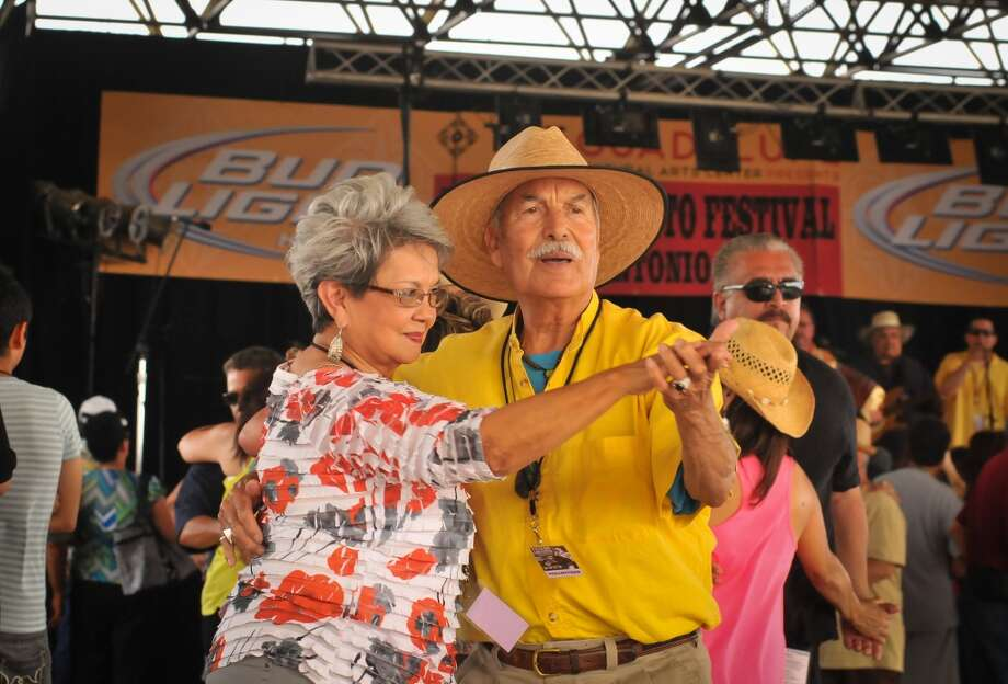 Sara DeLaGarza and Rudy Garza dance during the 32nd Annual Tejano Conjunto Festival Sunday, May 19, 2013, at Rosedale Park in San Antonio.