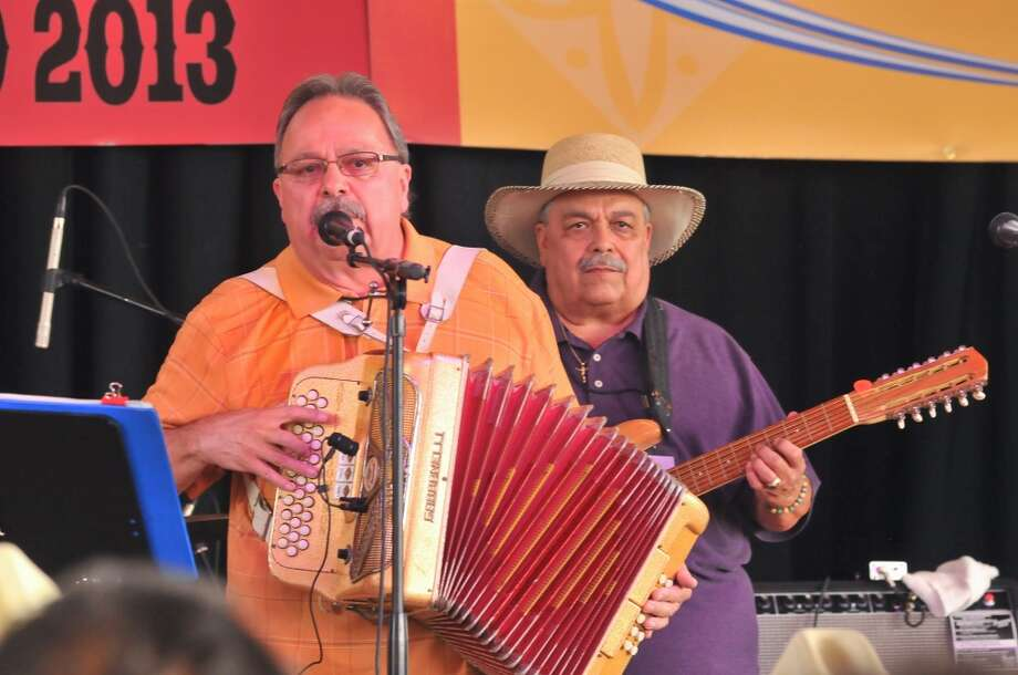 Carlos Johnson (left) and his brother Juan Johnson perform with Chalito Johnson y Los Paisanos during the 32nd Annual Tejano Conjunto Music Festival at Rosedale Park on Sunday afternoon, May 19, 2013.