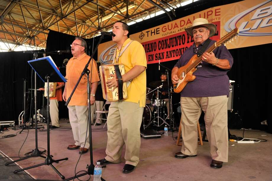 Carlos Johnson (left), Ariel Johnson (center) and Juan Johnson (right) of Chalito Johnson y Los Paisanos perform during the 32nd Annual Tejano Conjunto Festival Sunday afternoon, May 19, 2013, at Rosedale Park.