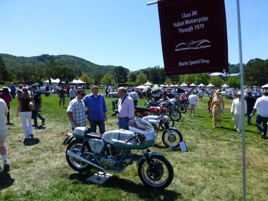 A row of vintage Italian motorcycles.