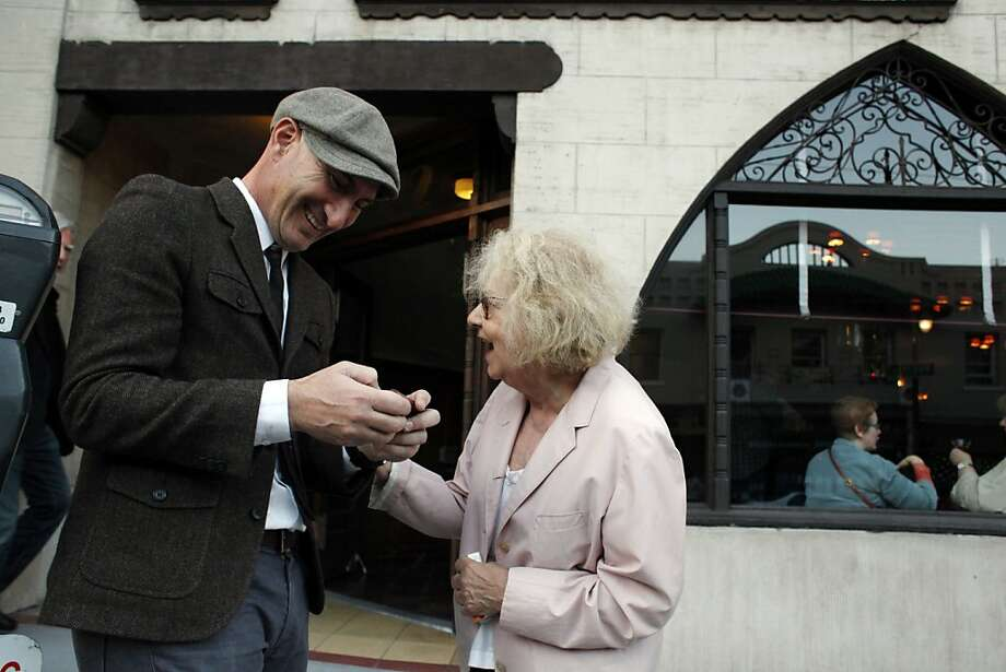Jeannette Etheredge, owner of Tosca, smiles after Joe Rosato, Jr., shows her a photo he took of her outside the famed San Francisco bar on Sunday. Tosca Cafe in San Francisco, Calif., will be closing for a renovation and crowds gathered out the door to bid the San Francisco icon farewell on Sunday, May 19, 2013. Photo: Carlos Avila Gonzalez, The Chronicle