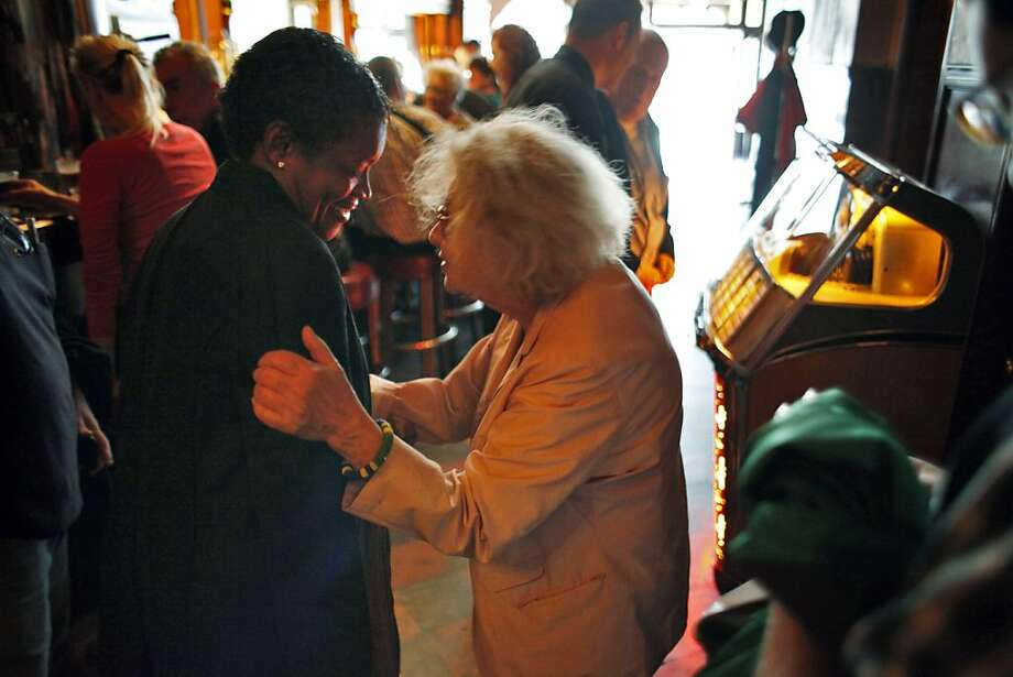 Jeannette Etheredge, right, speaks with Susan Brown on Sunday. Tosca Cafe in San Francisco, Calif., will be closing for a renovation and crowds gathered out the door to bid the San Francisco icon farewell on Sunday, May 19, 2013. Photo: Carlos Avila Gonzalez, The Chronicle