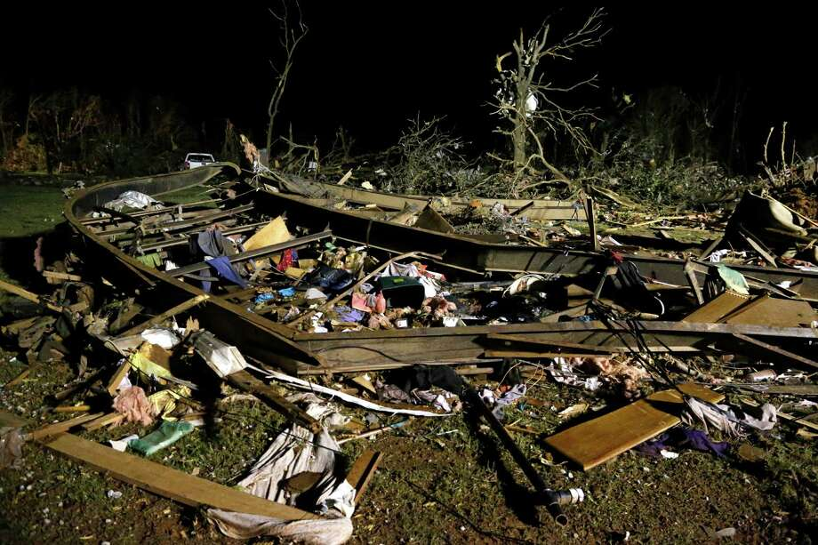 The frame of a mobile home is pictured with debris after a tornado hit a mobile home park near Dale, Okla., Sunday, May 19, 2013. Photo: AP